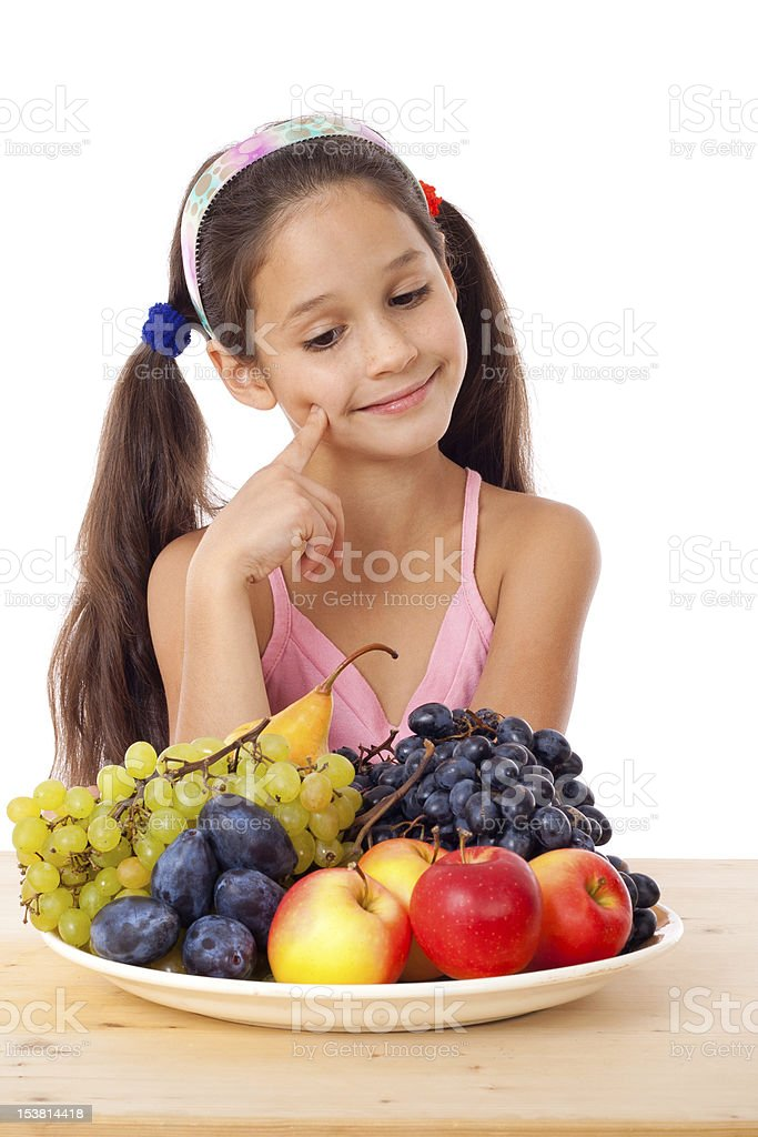 Girl with plate of fruit royalty-free stock photo