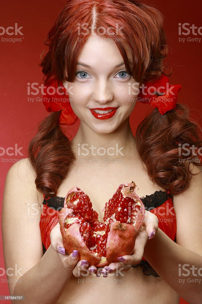 Girl with pomegranate royalty-free stock photo