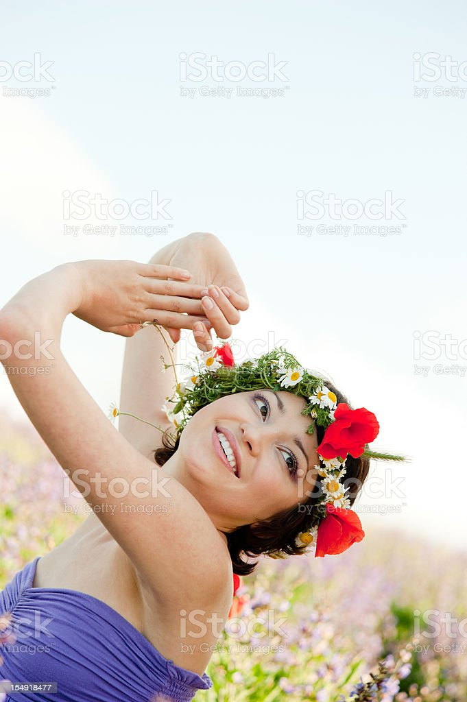 Girl with poppies in hairs royalty-free stock photo