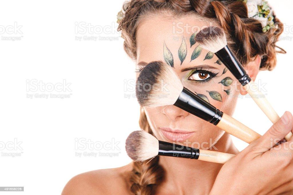 Girl with powder brush stock photo