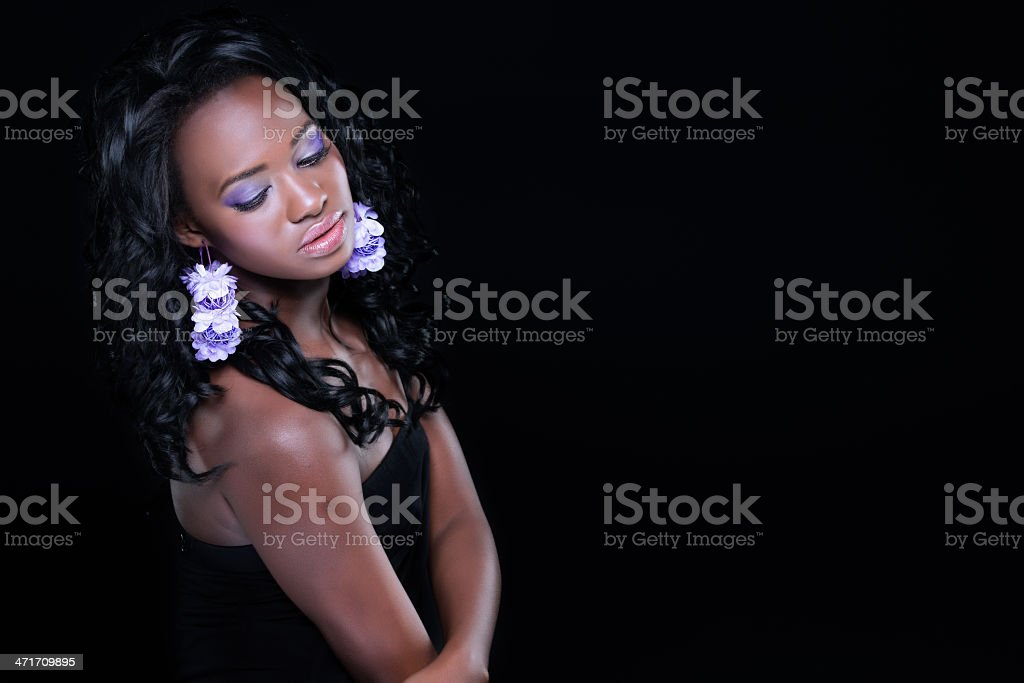 Girl with purple earings royalty-free stock photo