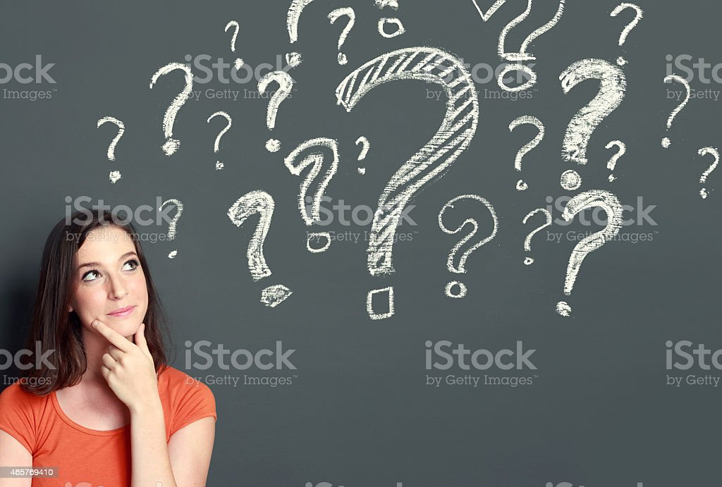 girl with question mark stock photo