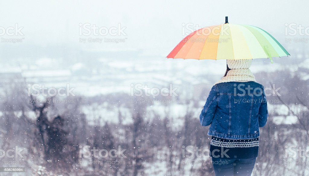 Girl with rainbow umbrella stock photo