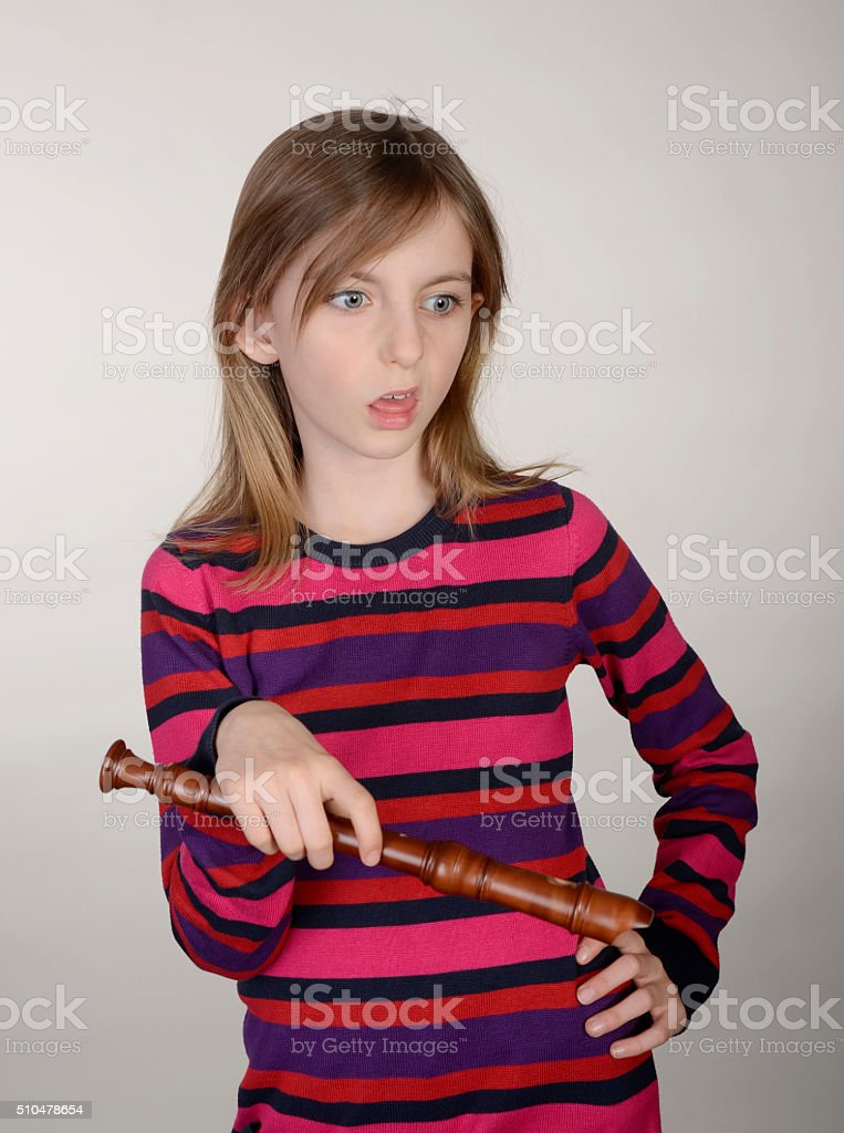 girl with recorder stock photo
