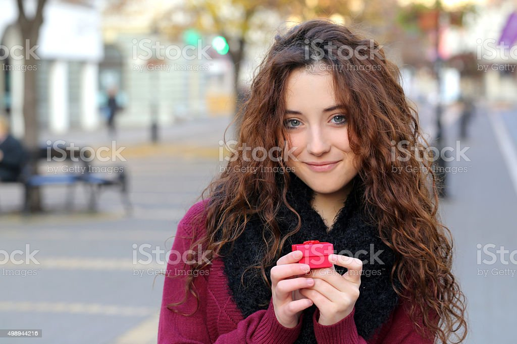 girl with red gift stock photo