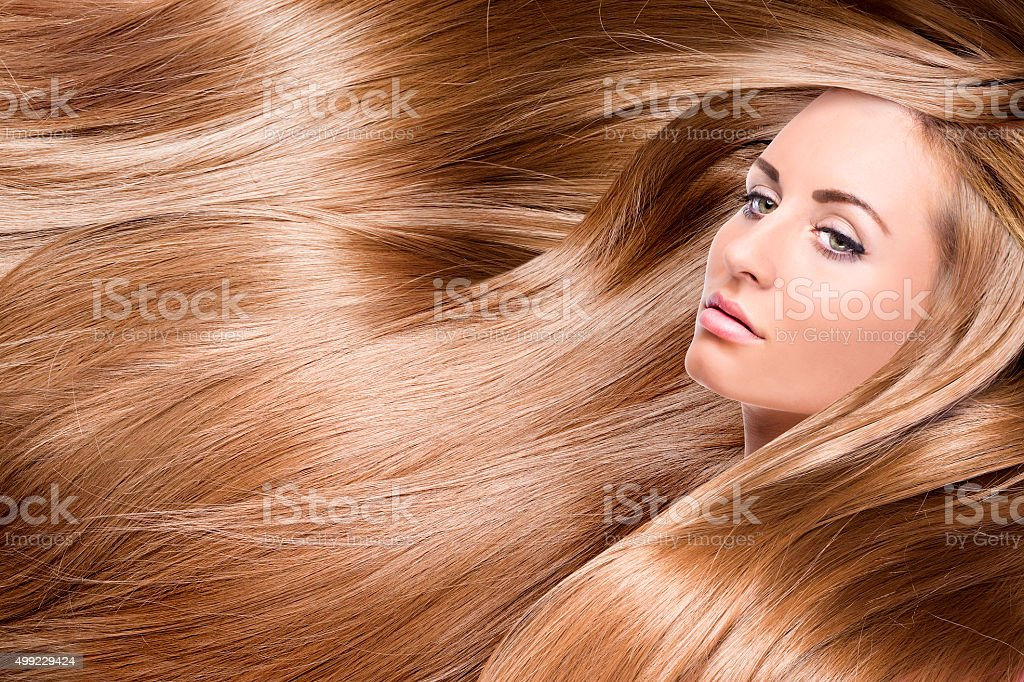 girl with red shining hair stock photo