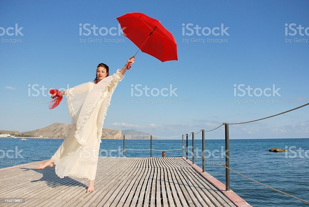 Girl with red umbrella royalty-free stock photo