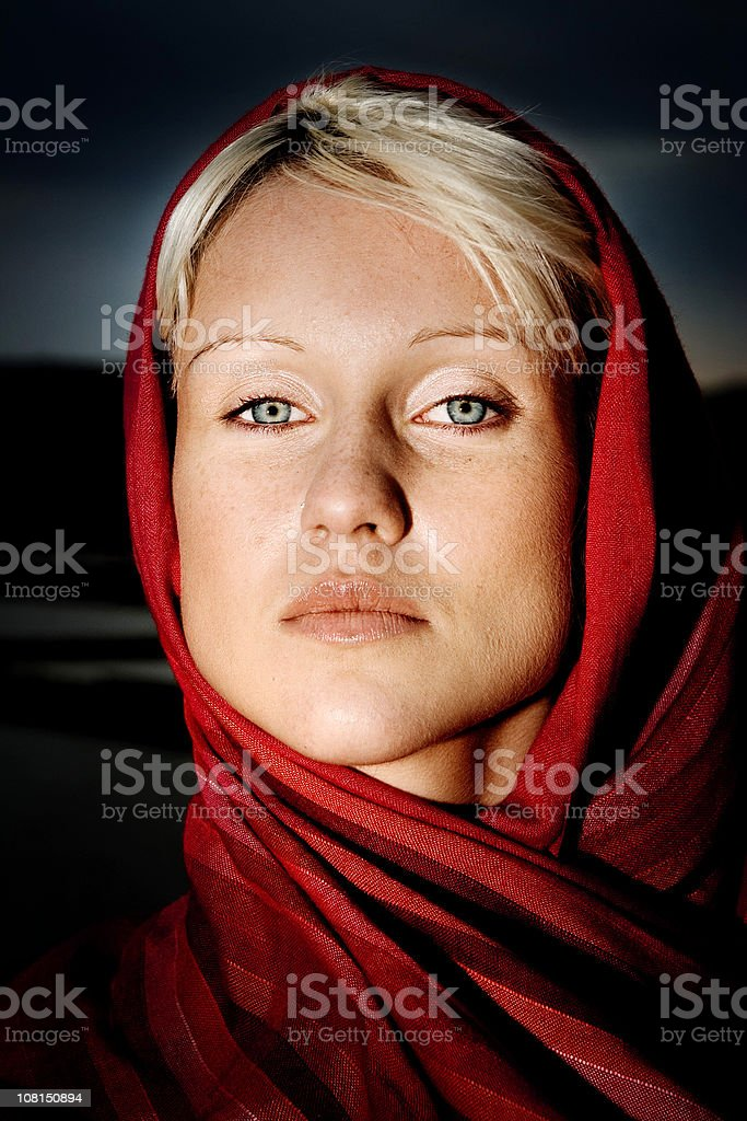 Girl with red veil stock photo