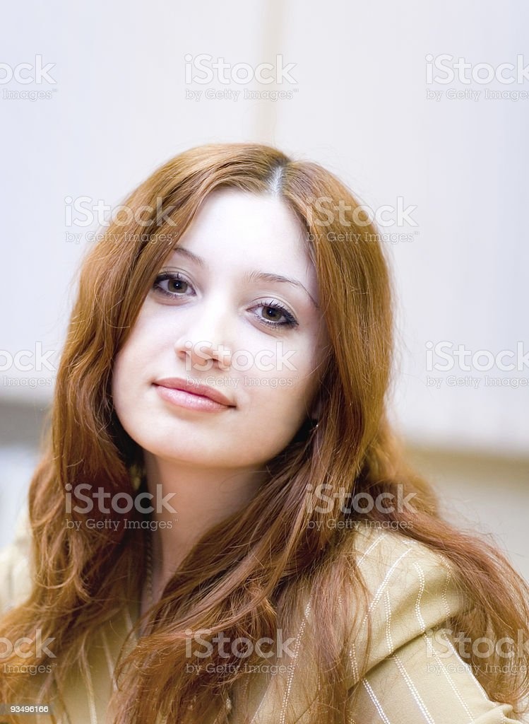 Girl with reddish hair in office royalty-free stock photo