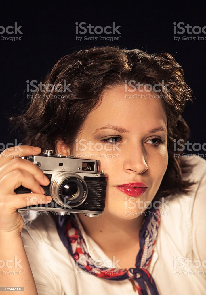 Girl with retro camera royalty-free stock photo