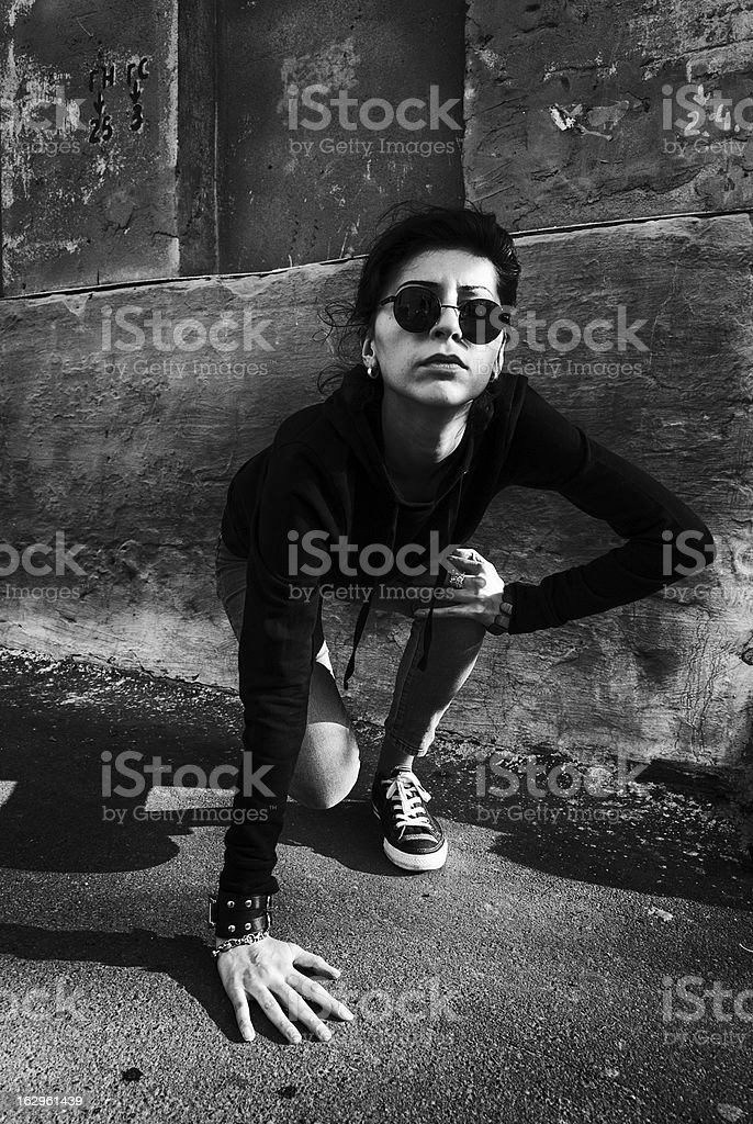 Girl with round black glasses up from her knees royalty-free stock photo