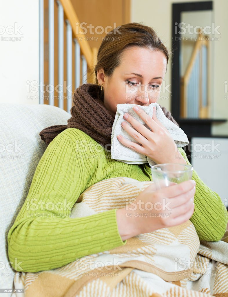 Girl with scarf dissolving medicine stock photo