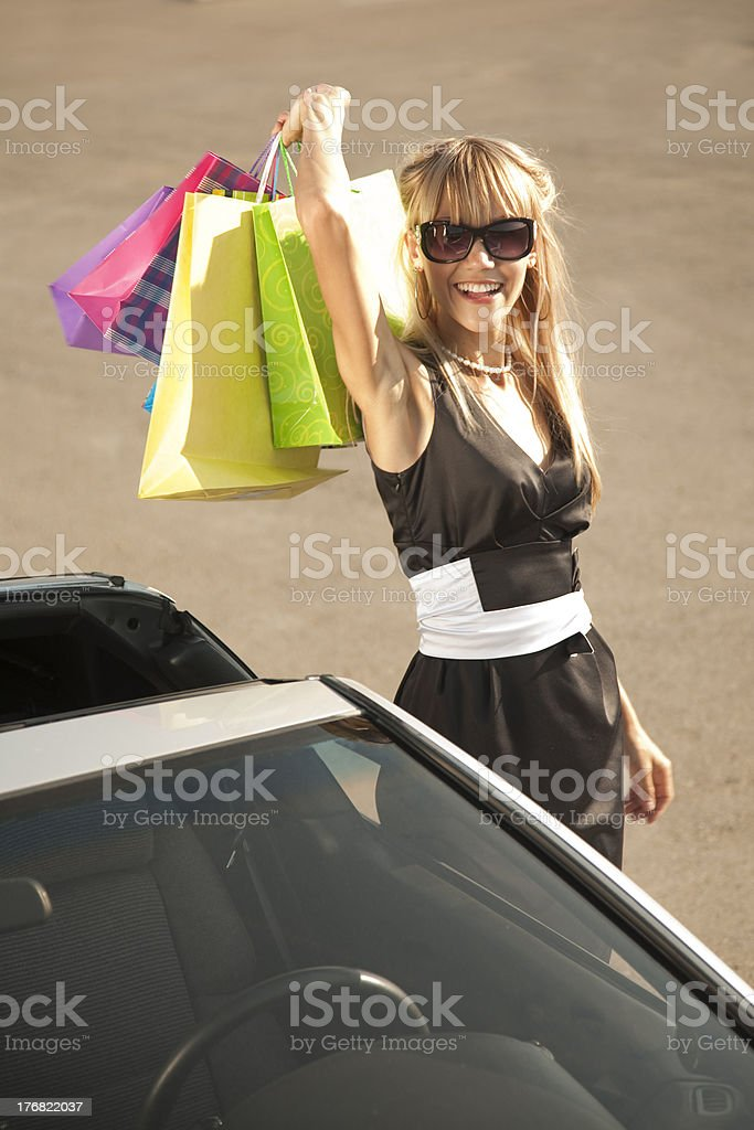Girl with shopping bags near  her car royalty-free stock photo