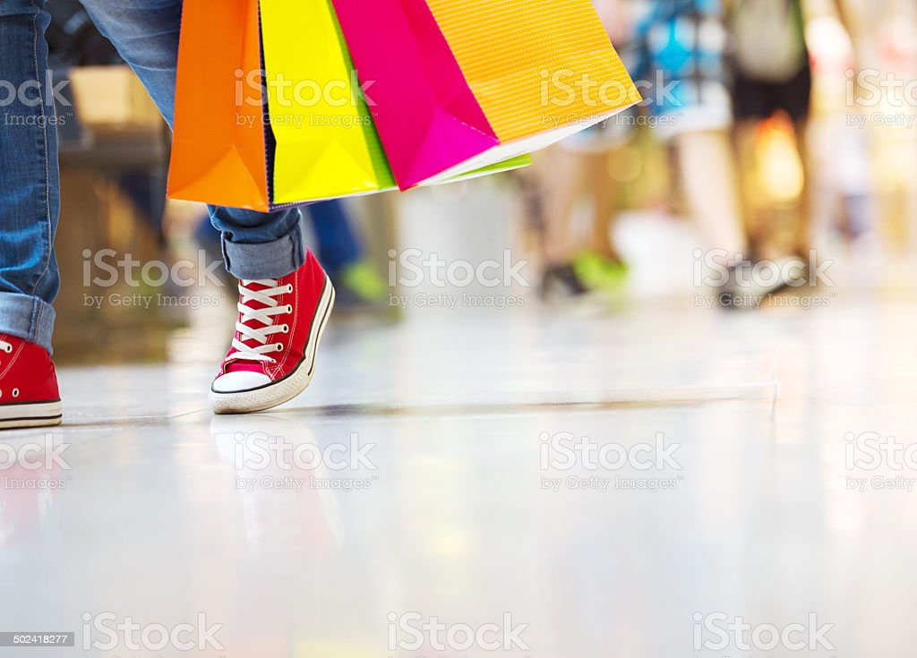 Girl with shopping bags stock photo