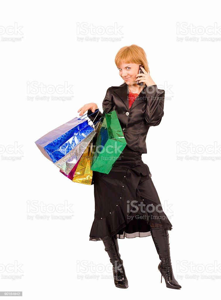 girl with shopping bags talking on the cellphone royalty-free stock photo