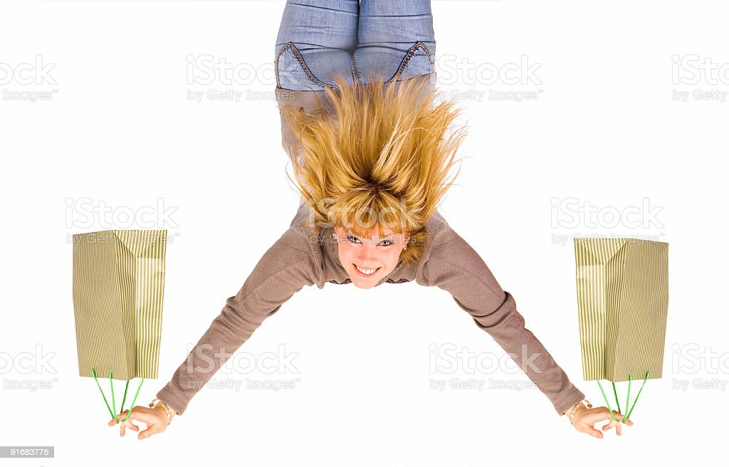 girl with shopping bags upside down royalty-free stock photo