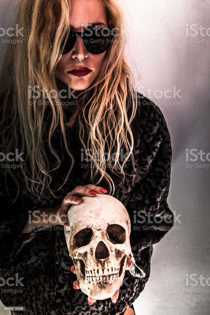 Girl with skull stock photo