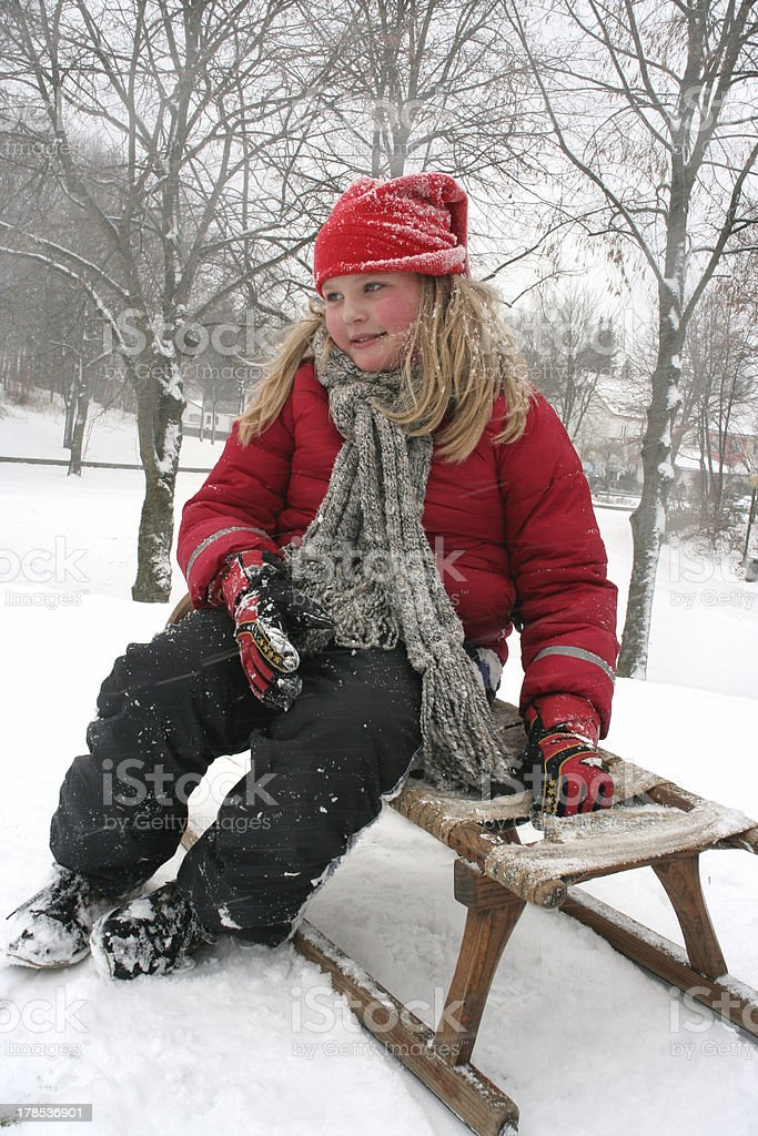 Girl with sledge royalty-free stock photo