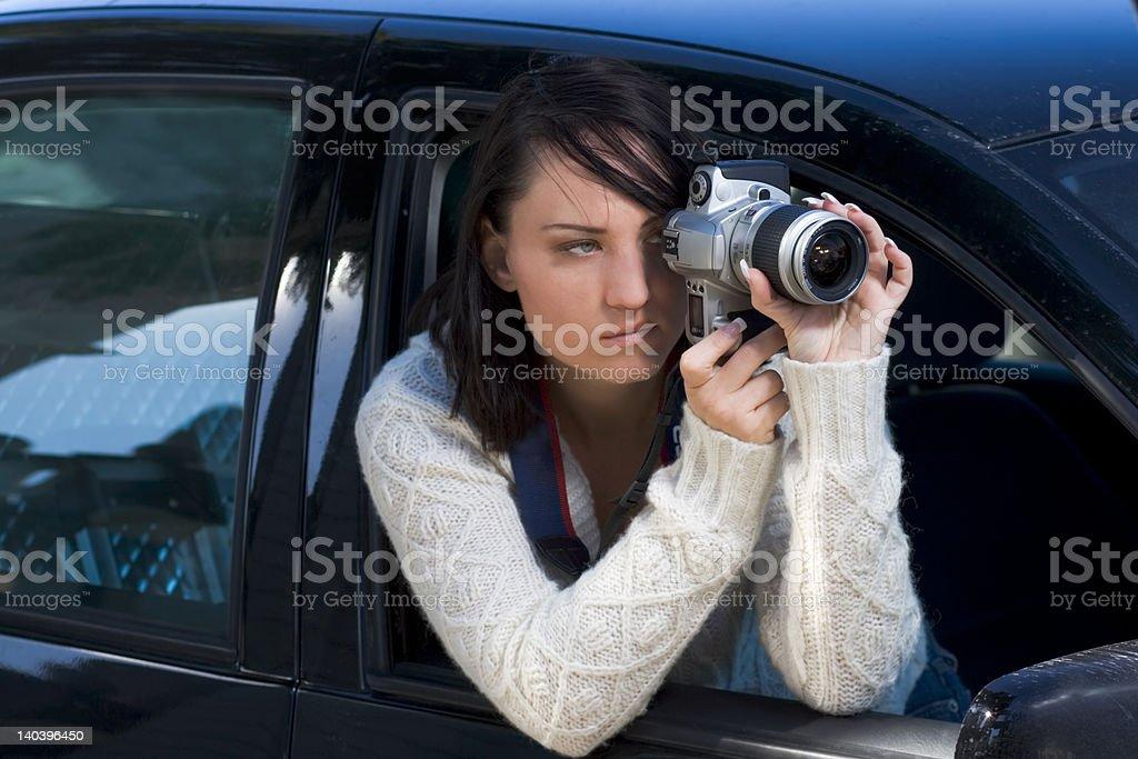 Girl with SLR photo camera stock photo