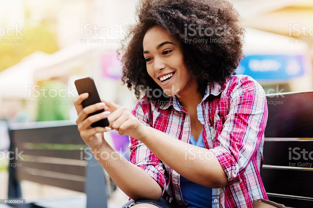 Girl with smart phone stock photo