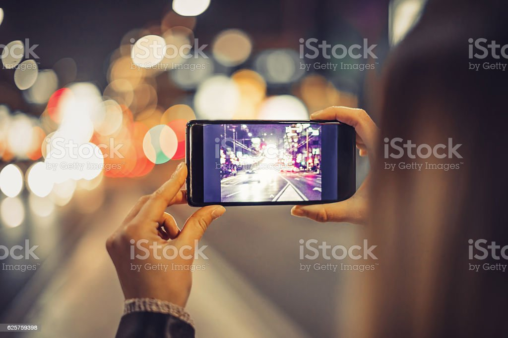 Girl with smartphone in the city stock photo