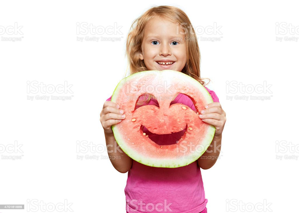 Girl with smiley of watermelon stock photo