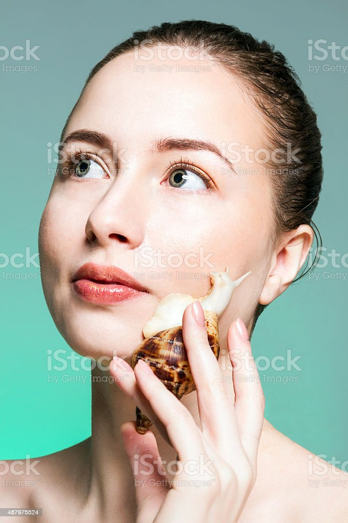Girl with snail royalty-free stock photo