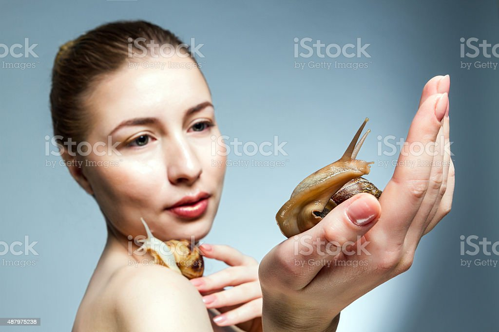 Girl with snails royalty-free stock photo