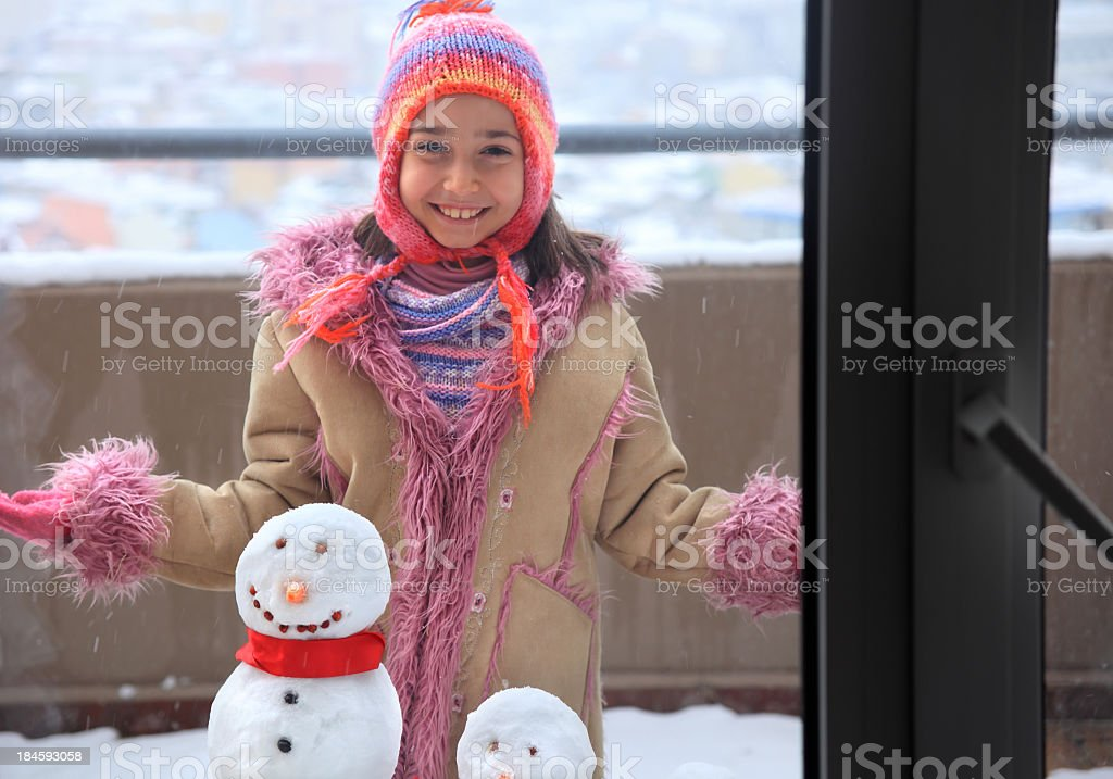 girl with snowman royalty-free stock photo