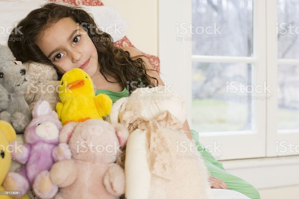 Girl with soft toys stock photo