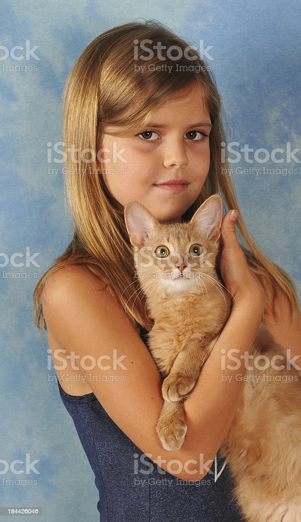 Girl with somali kitten stock photo