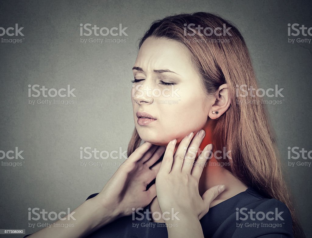 girl with sore throat neck colored in red. stock photo
