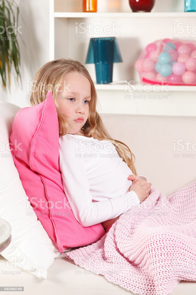 Girl with stomach ache stock photo
