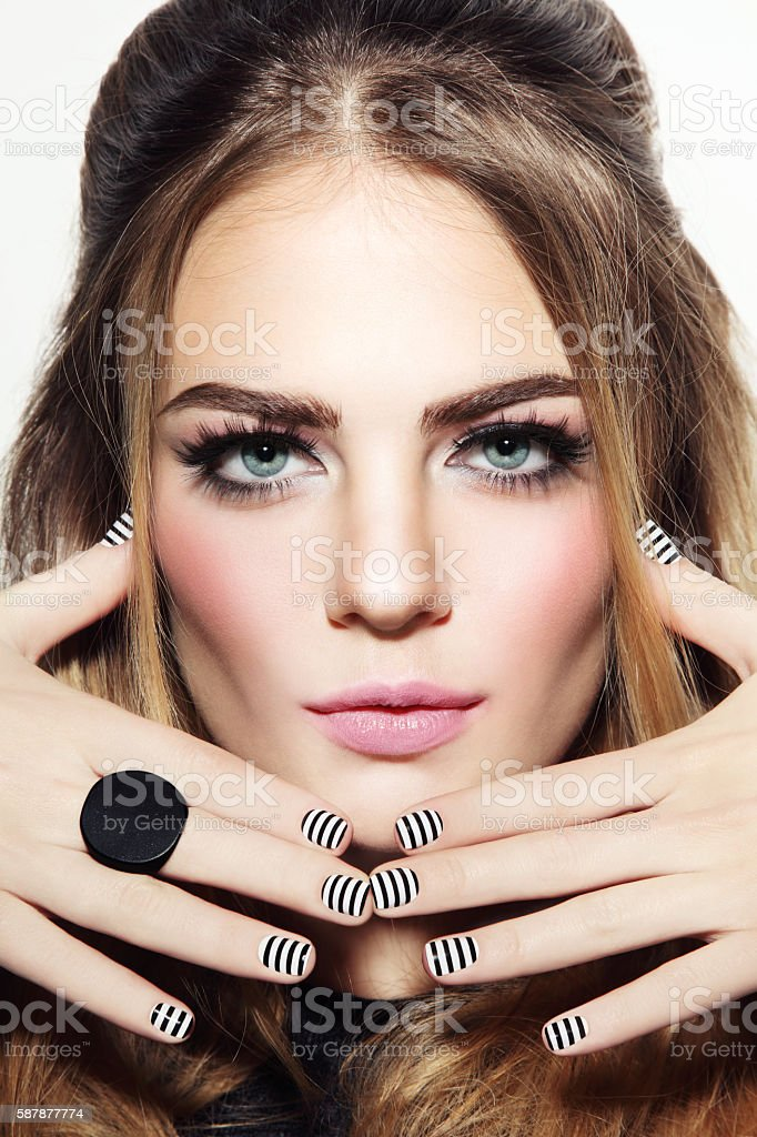 Girl with striped manicure stock photo