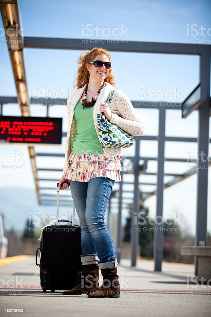 Girl with Suitcase on BART Platform royalty-free stock photo