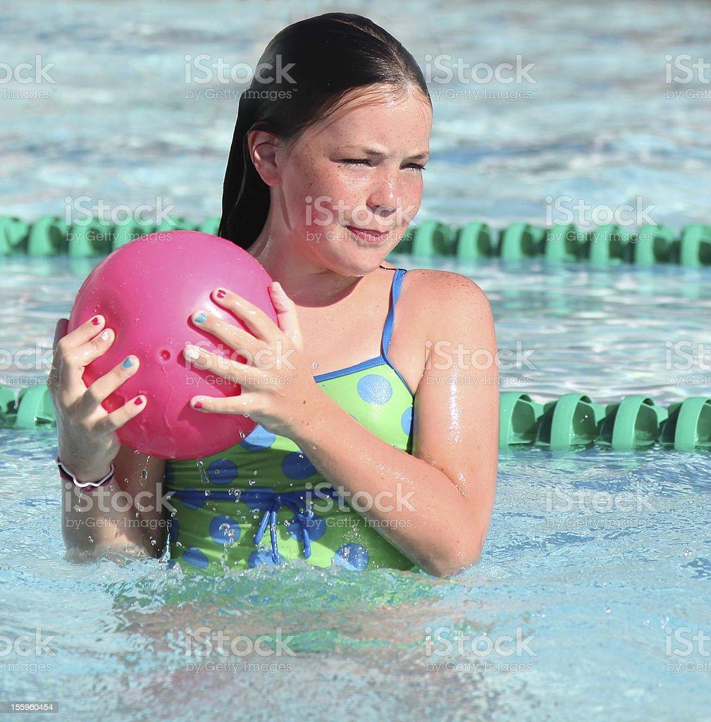 Girl with suntan in swimming pool royalty-free stock photo