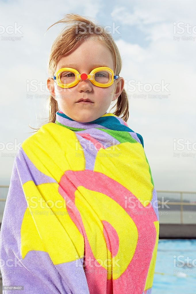 Girl with swim goggles stock photo