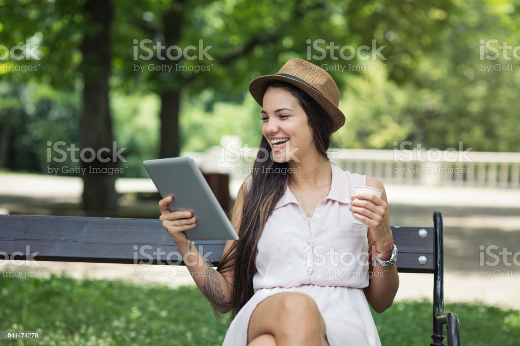 Girl with tablet and afternoon coffee stock photo