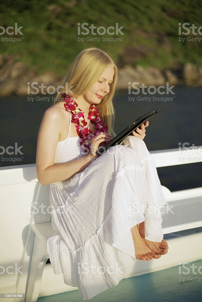 Girl with tablet PC on ship royalty-free stock photo