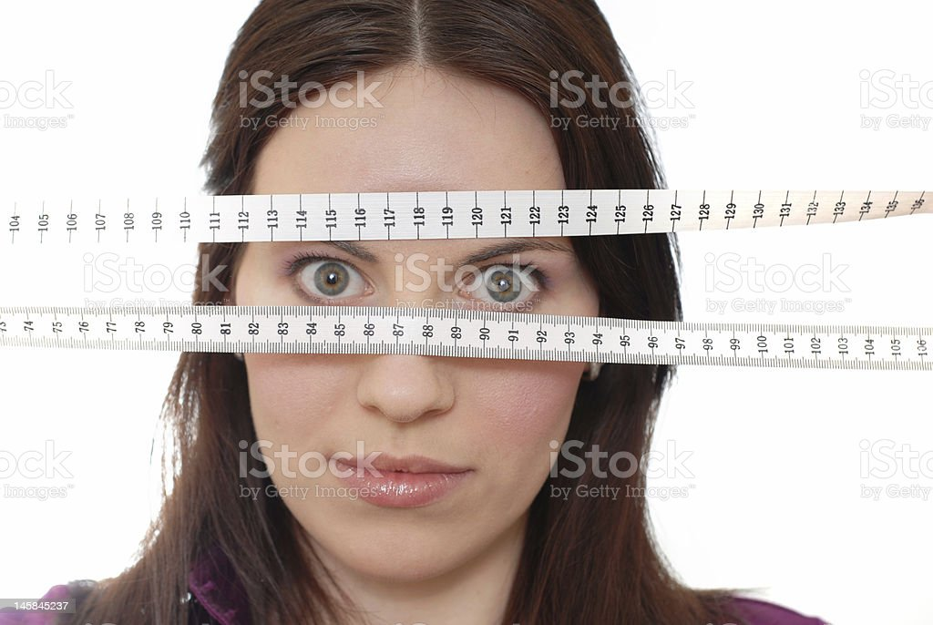 Girl with tape-line royalty-free stock photo