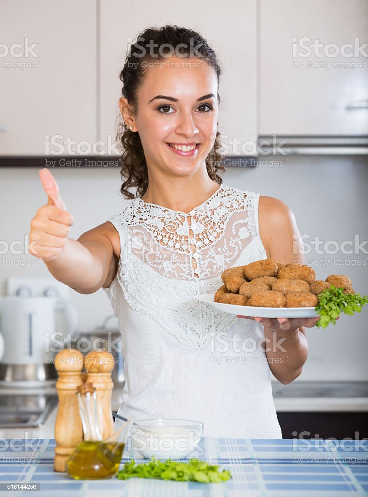 girl with tasty breadcrumbed crocchette stock photo
