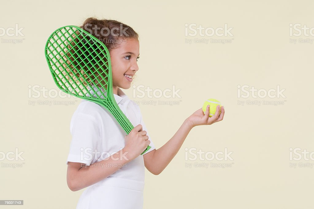 Girl with tennis racket and ball royalty-free stock photo