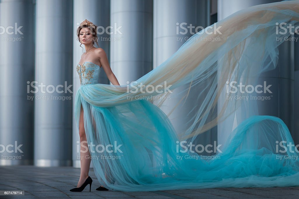 Girl with the developing dress. stock photo