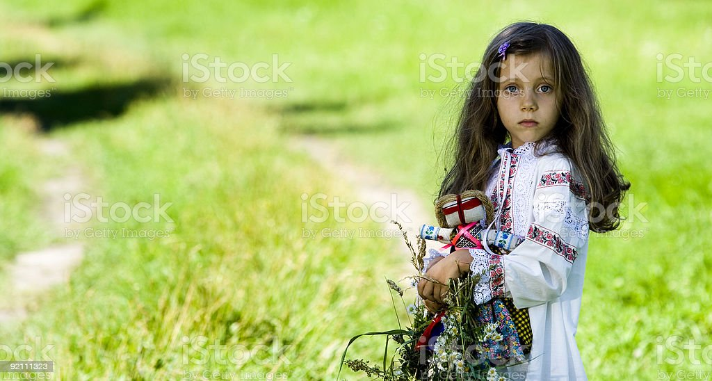Girl with the folk toy royalty-free stock photo