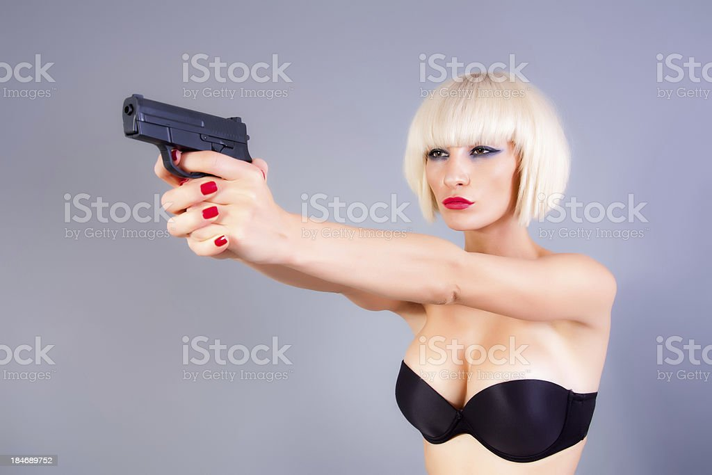 Girl with the gun royalty-free stock photo