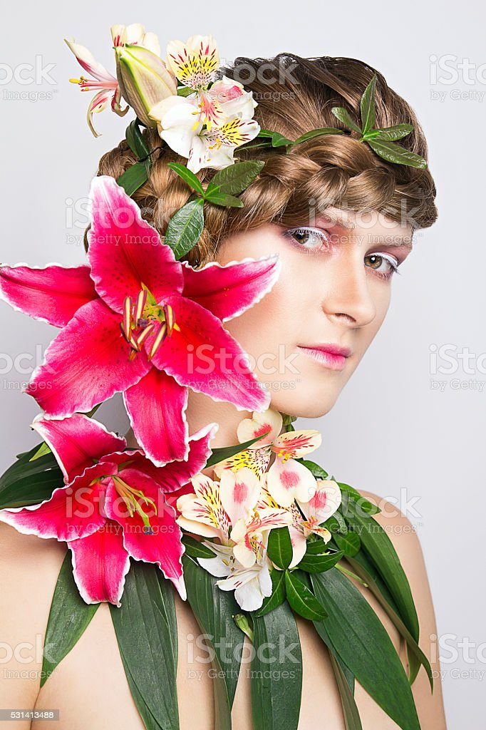 Girl with the lilies stock photo