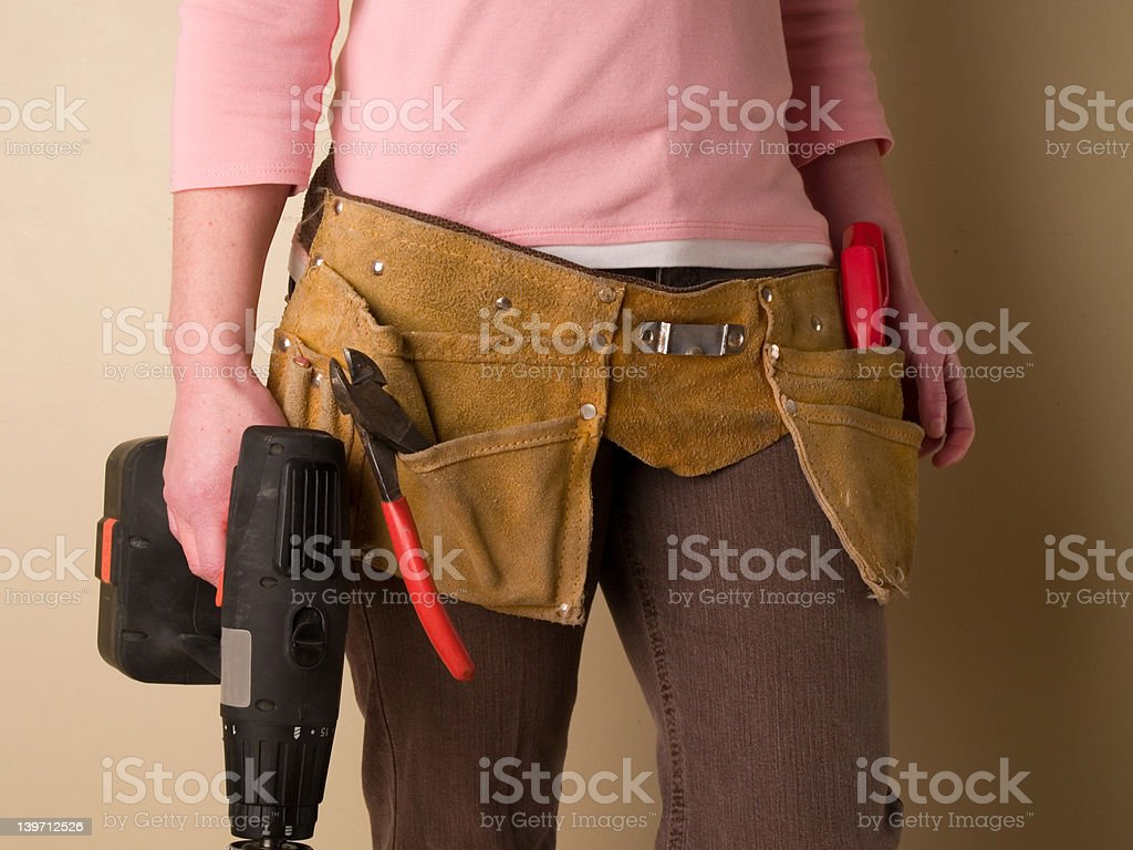 Girl with toolbelt royalty-free stock photo