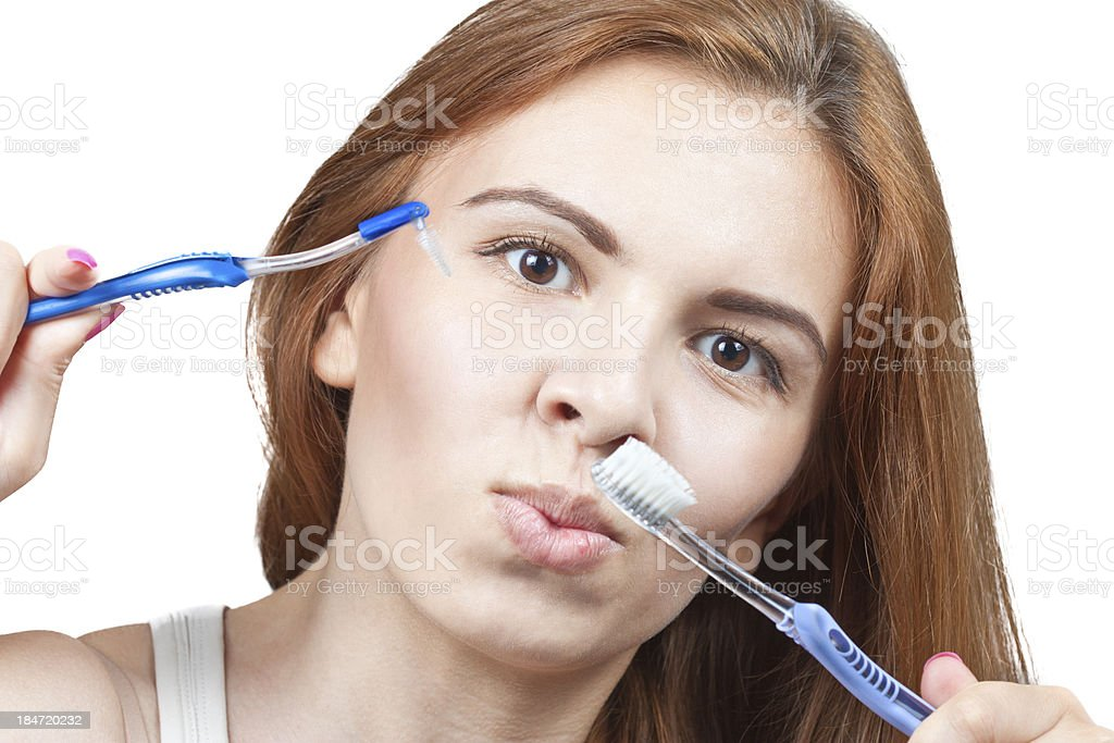 Girl with toothbrush royalty-free stock photo