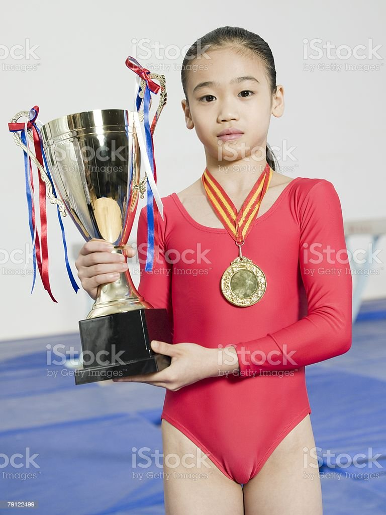 Girl with trophy and medal stock photo