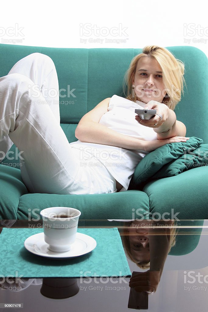 Girl with TV remote royalty-free stock photo